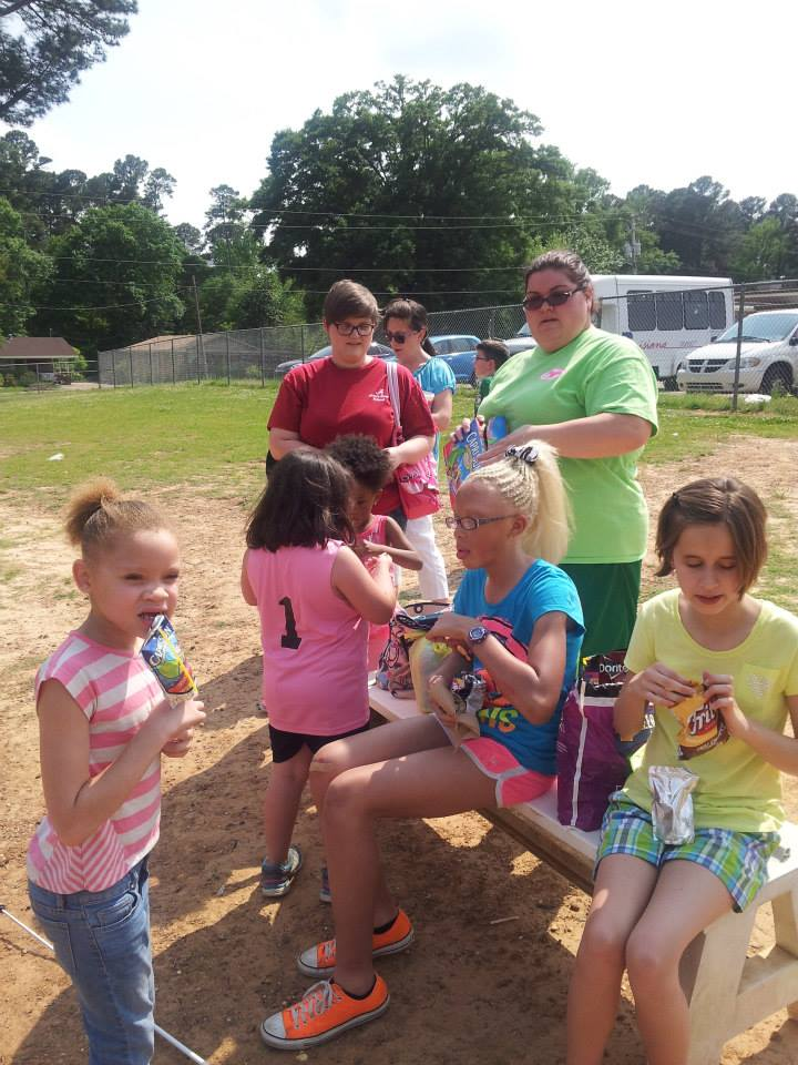 Saturday club students enjoying some refreshments after going on an egg hunt and playing
