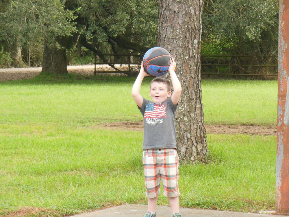 Strider playing basketball