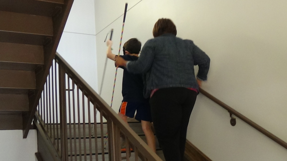 Sheena and student climb the stairs using nonvisual techniques