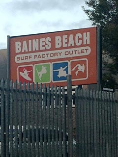 Baines Beach surf factory outlet.