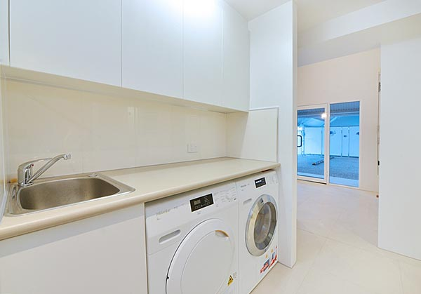 Fully equipped laundry with Miele appliances