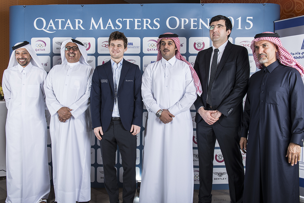 Mohamed Al-modiahki, Khalifa Al-Hitmi, Magnus Carlsen, Mr. Salem Al-Manaai, Vladimir Kramnik, and Dr. Nasser Abdulghani Al-Abdulghani