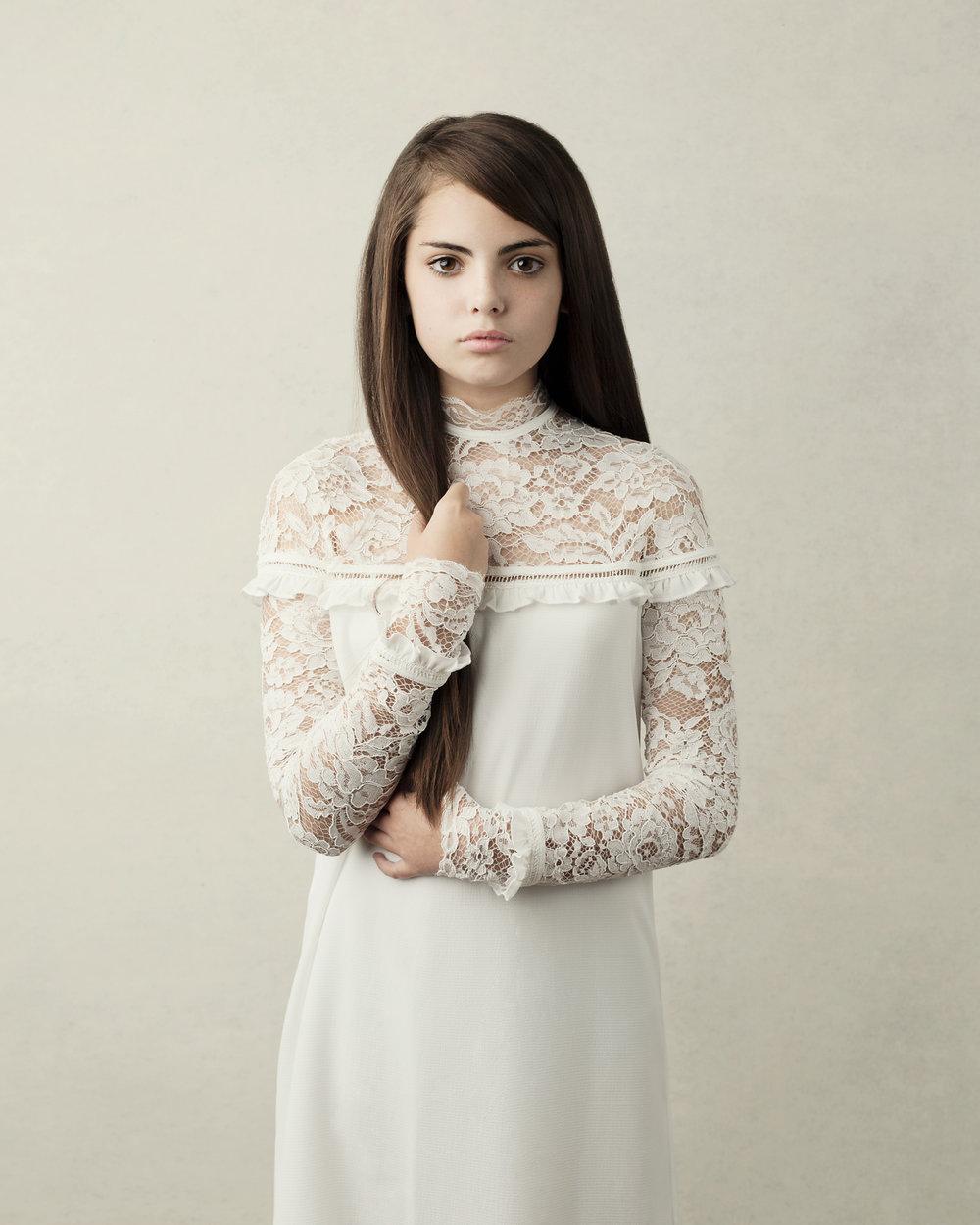 Isabella holding hair