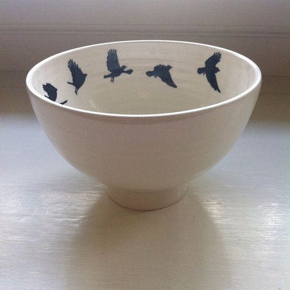 crow taking flight bowl