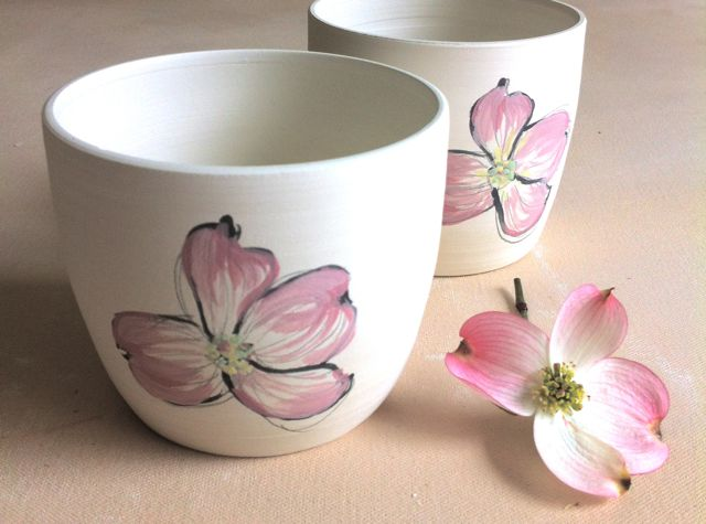 pair of dogwood sketches on porcelain cups
