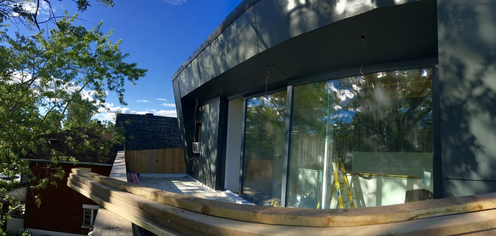 Final siding on the roof deck
