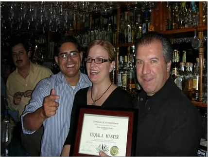Kimberly receiving her Tequila Masters certificate from the President of the State of Jalisco, Mexico and Tommy's Mexican Restaurant owner Julio Bermejo.