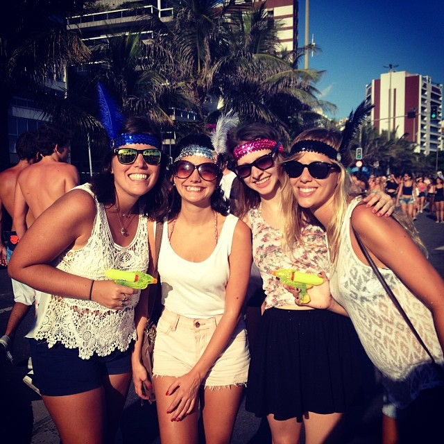 And (left) and her friends keeping cool and staying hydrated at Rio's Street Carnival.