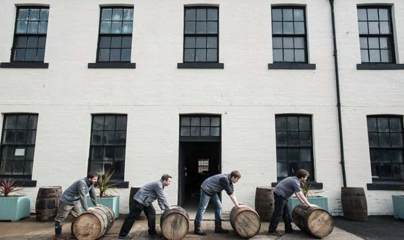 Rolling out the barrels at Eden Mill Distillery. Photo compliments of The Guardian.