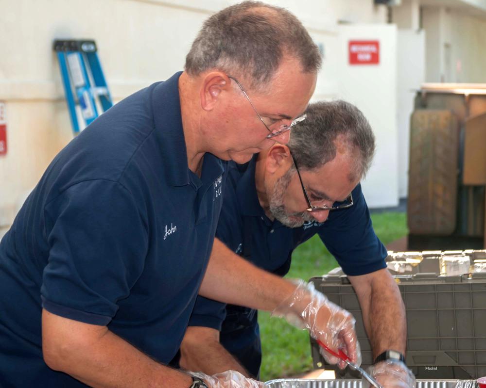John & Pedro building burgers.jpg