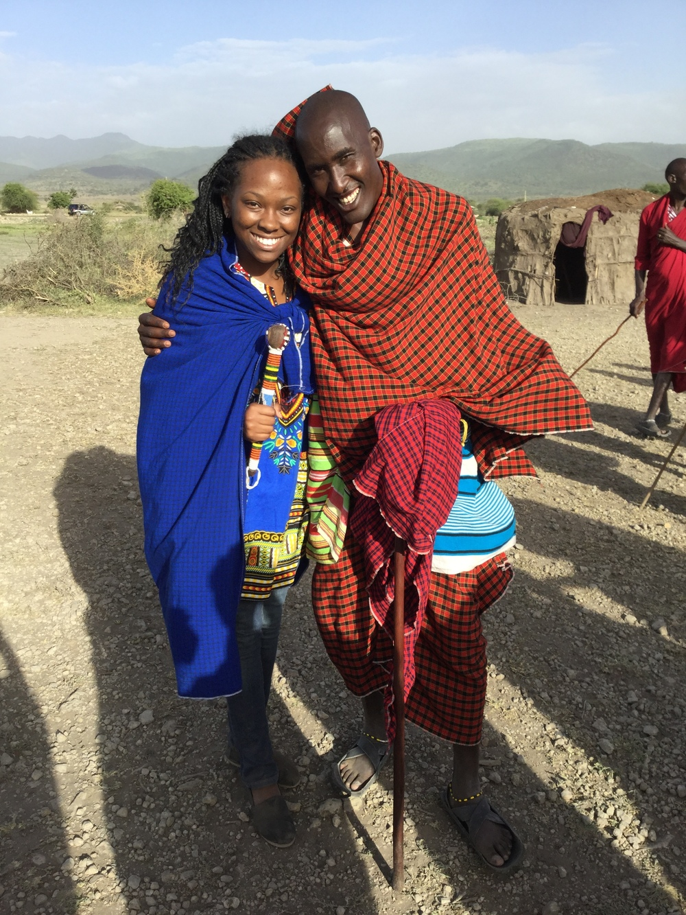 U.S. student Sha'von being welcomed during our visit to a local Maasai village.