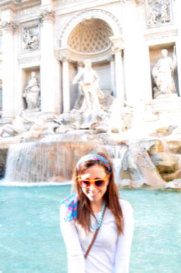 Tossing a coin into the Trevi