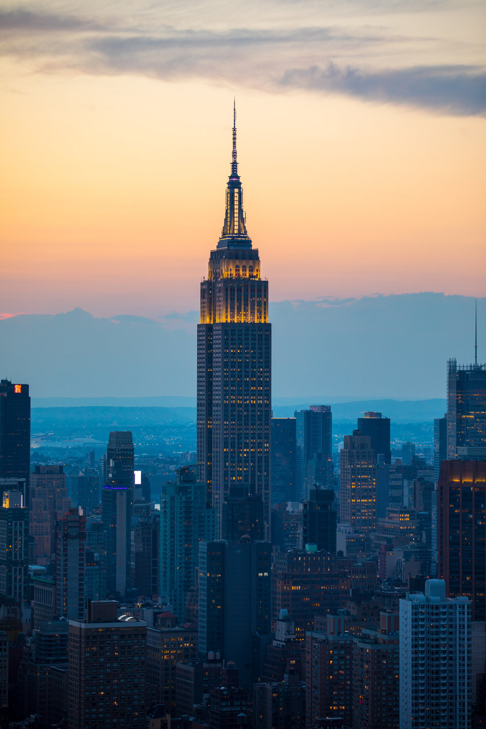 Helicopter over New York City sunset Empire State Building