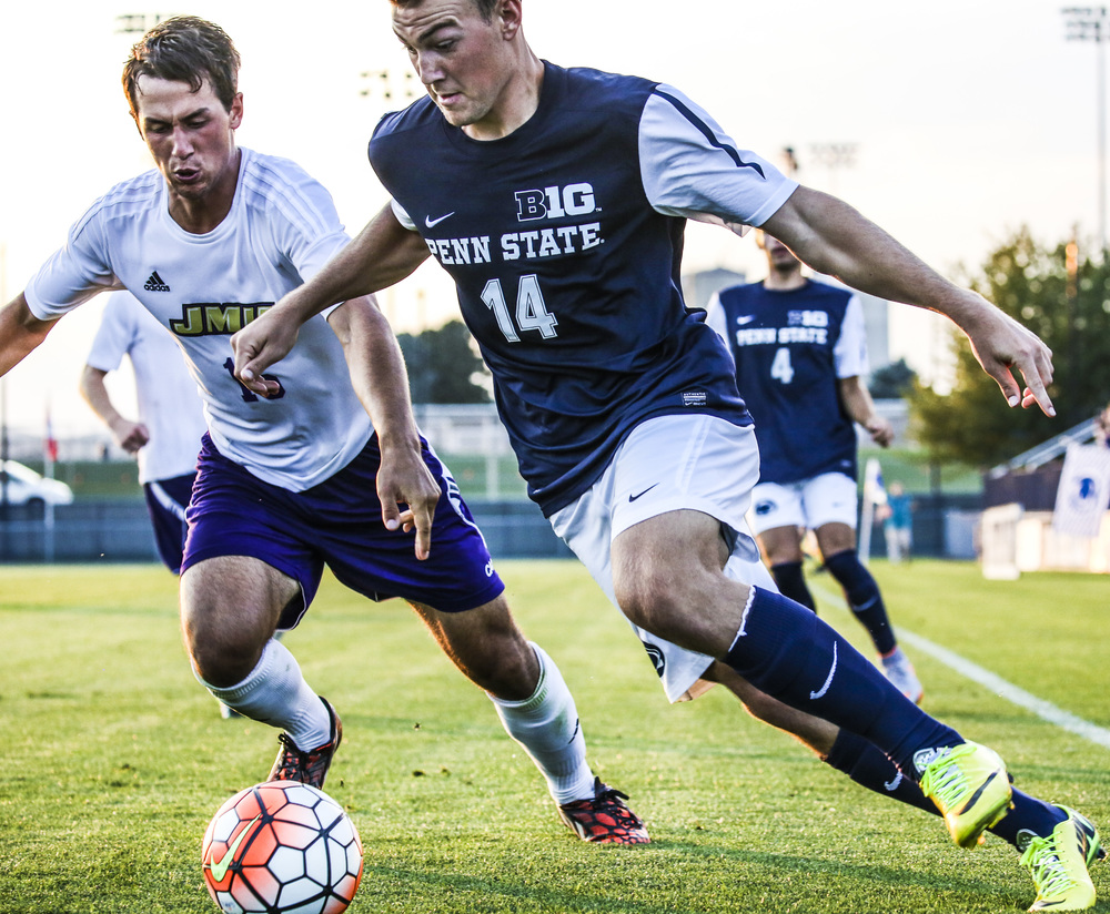Penn State's forward, Mac Curran (14), takes control of the ball while moving forward to the gate during the game against James Madison Univeristy on Sept 8, 2015.
