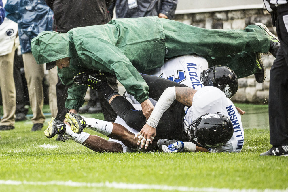 Buffalo Bulls' Linebacker Okezie Alozie (3) and Safety Ryan Williamson (26)  knock over a bystander on the sideline on Sept. 12, 2015.