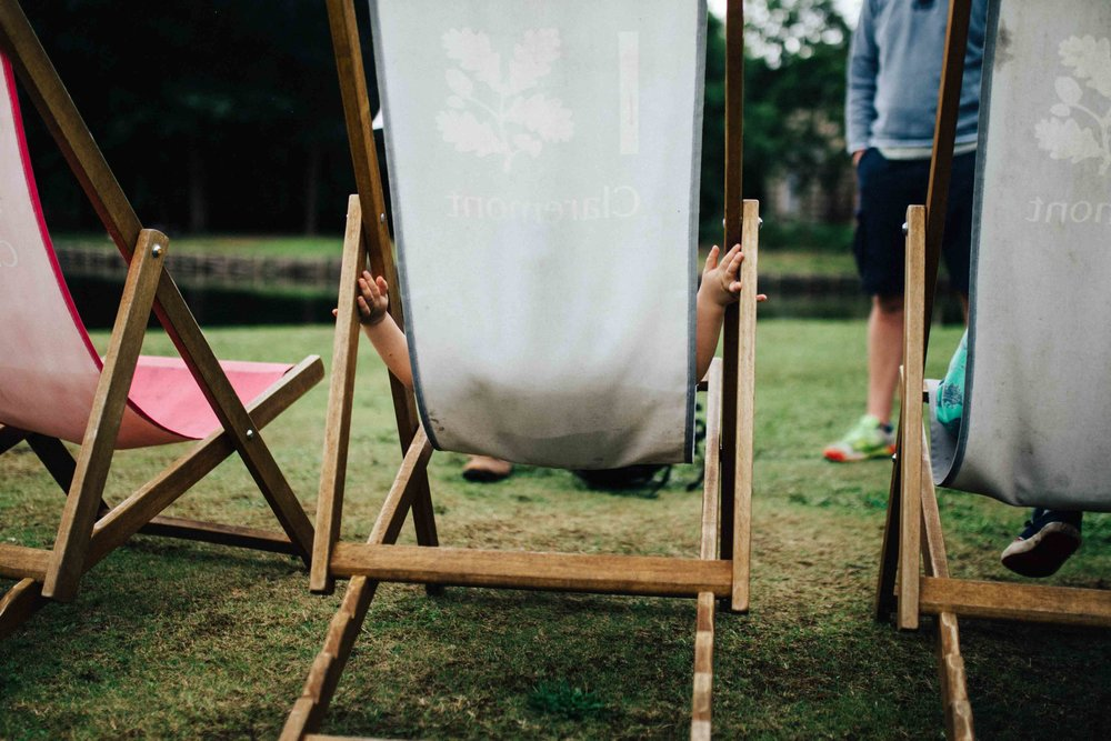 National Trust deck chairs with kid's hands during children and family photo session in Surrey