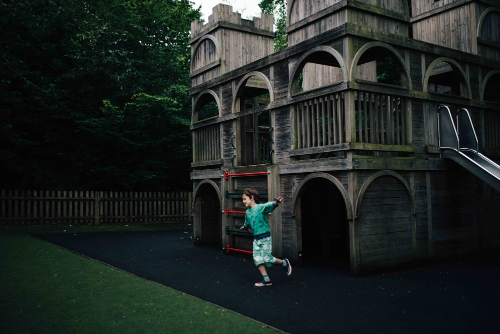 Boy doing the airplane in Claremont Landscape Garden's children's play area