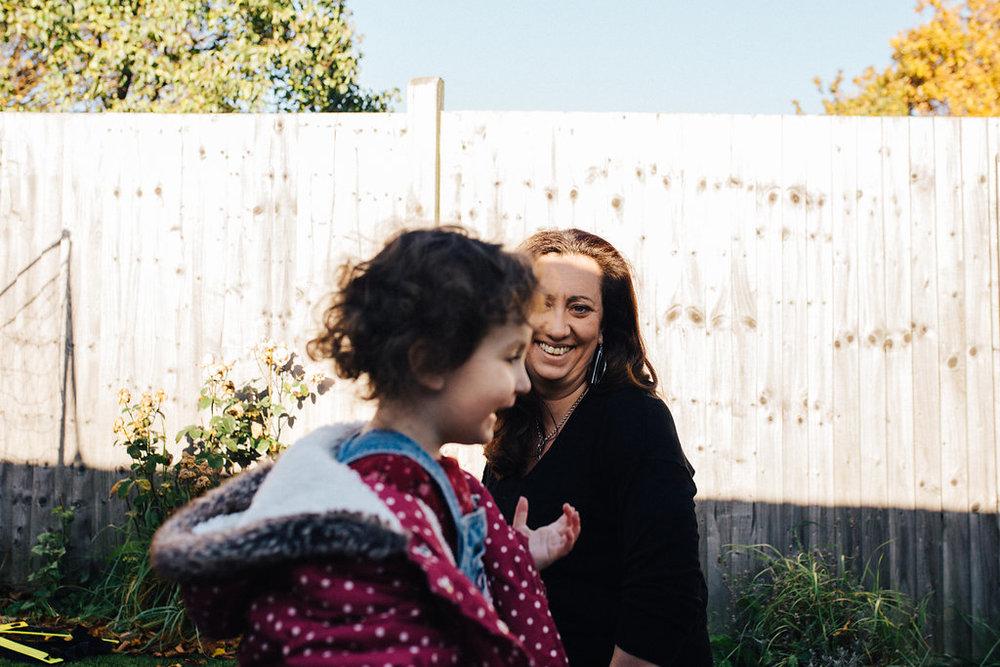 Alyssa looking at her daughter