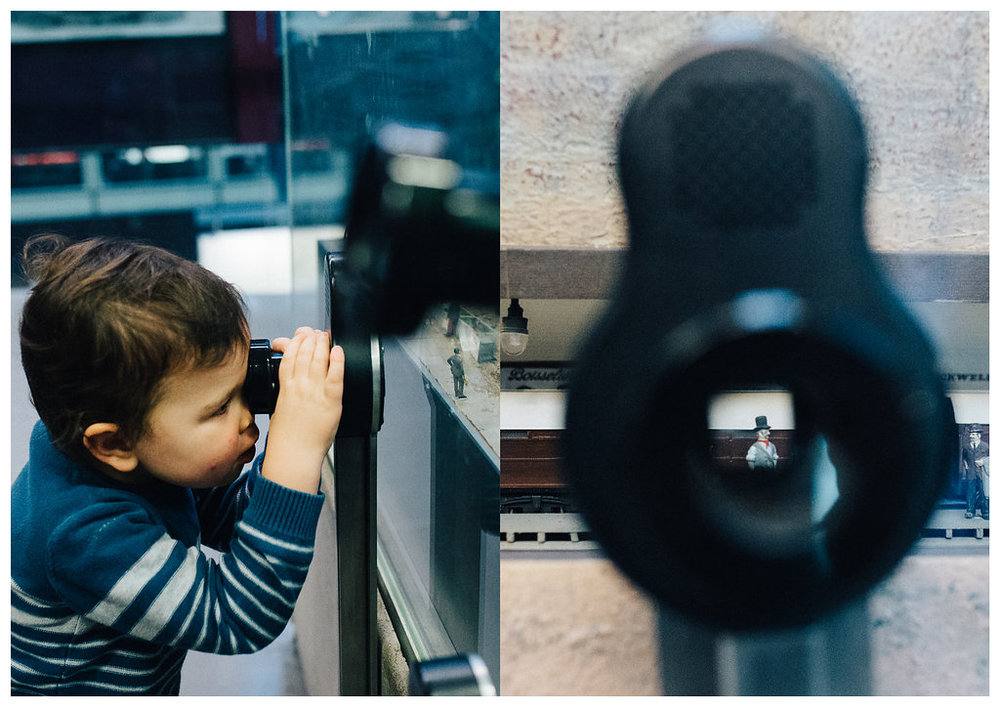 Boy looking at a scene at Museum of Transport in London