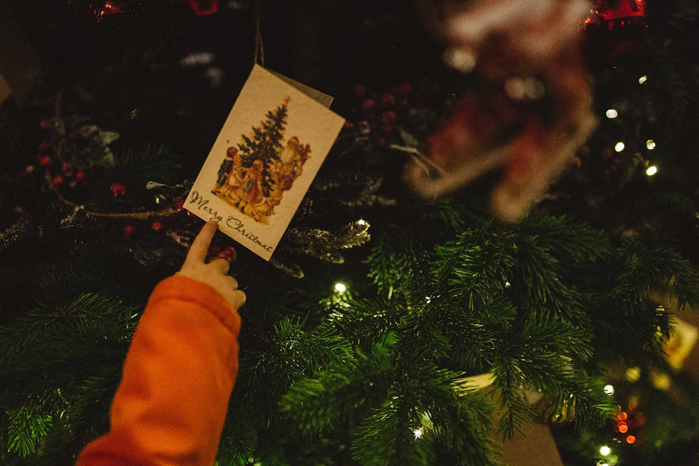 Boy pointing at Christmas card