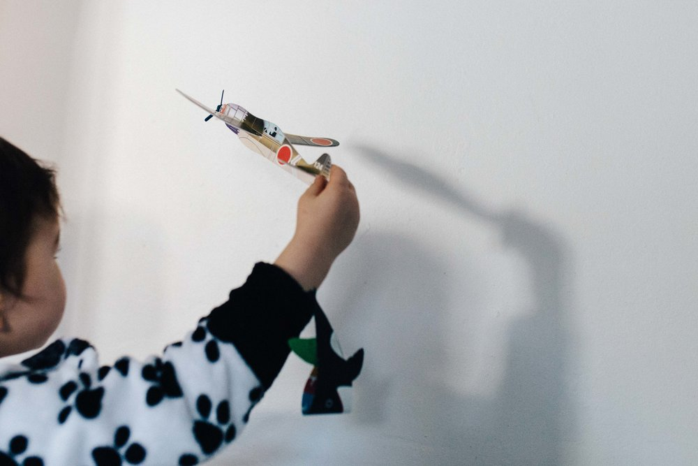 Boy playing with plane