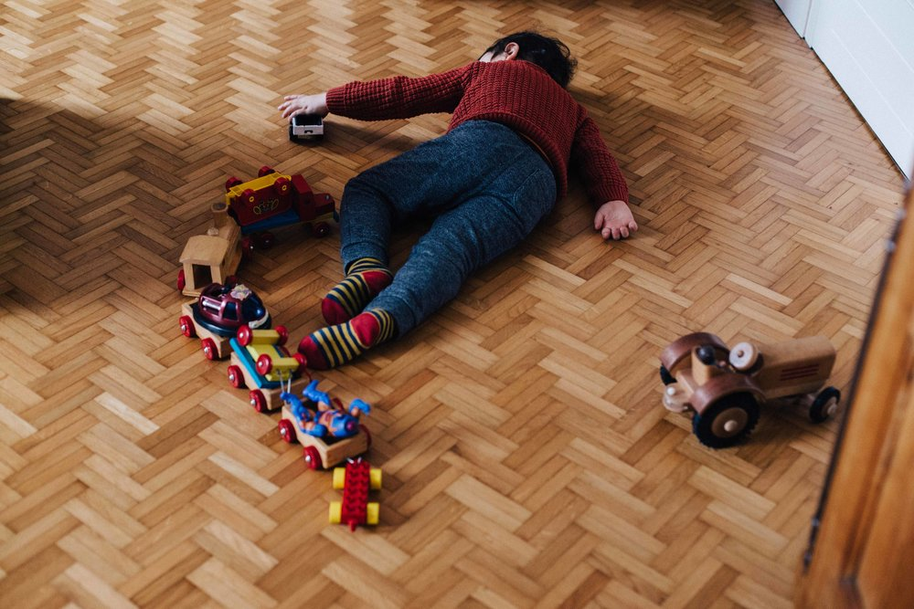 Boy playing with train on the floor