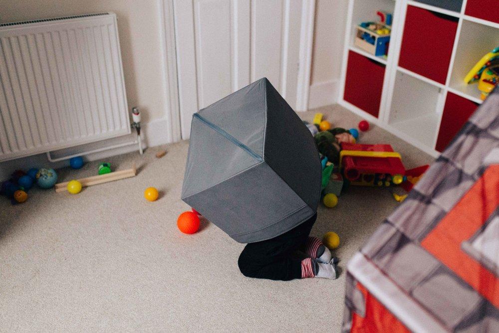 Boy hidding inside a box