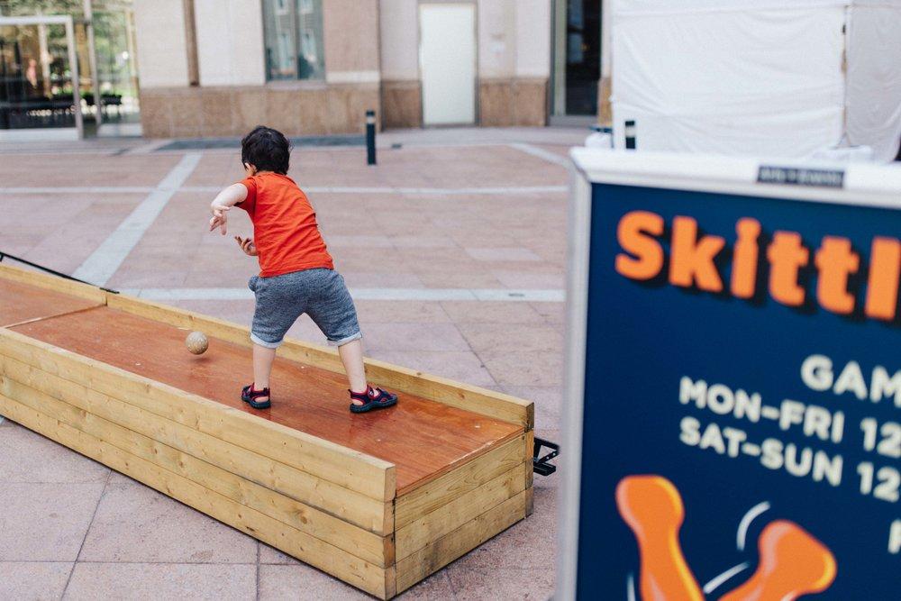 Boy playing skittles
