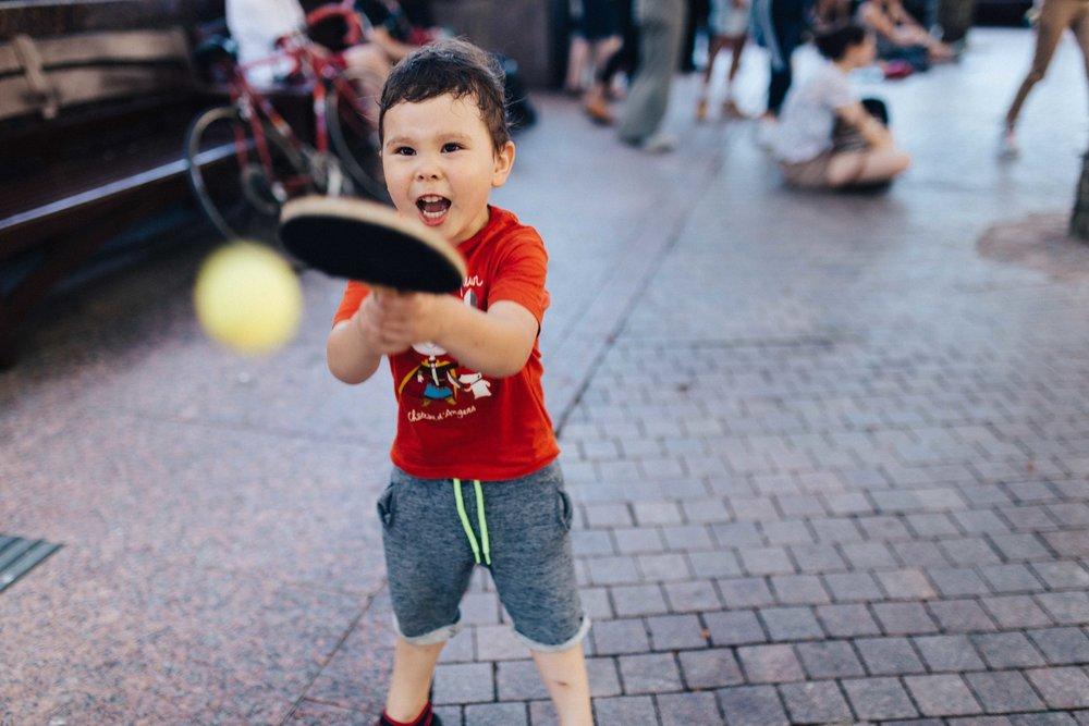 Boy playing ping pong