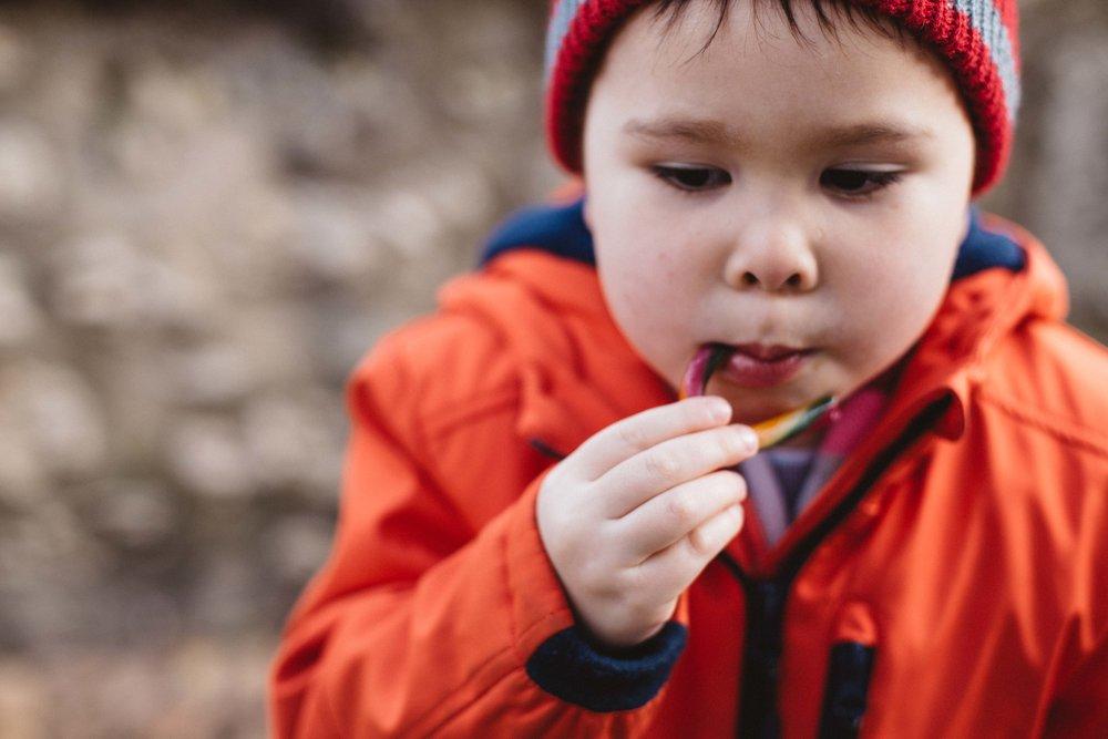 Boy eating a sweet