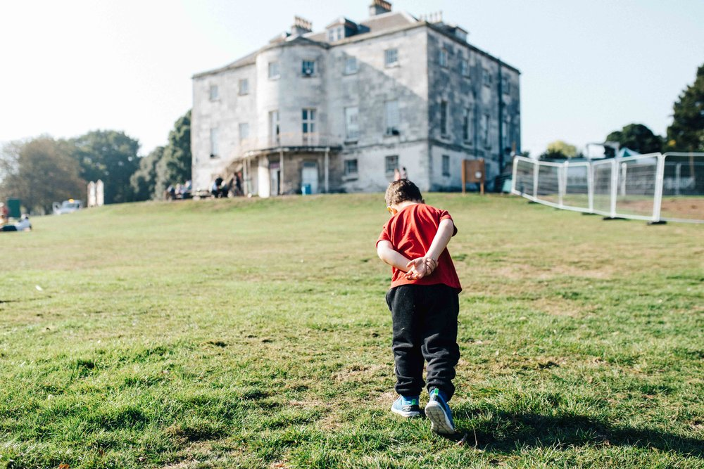 Boy walking in Beckenham Place Park during family photoshoot