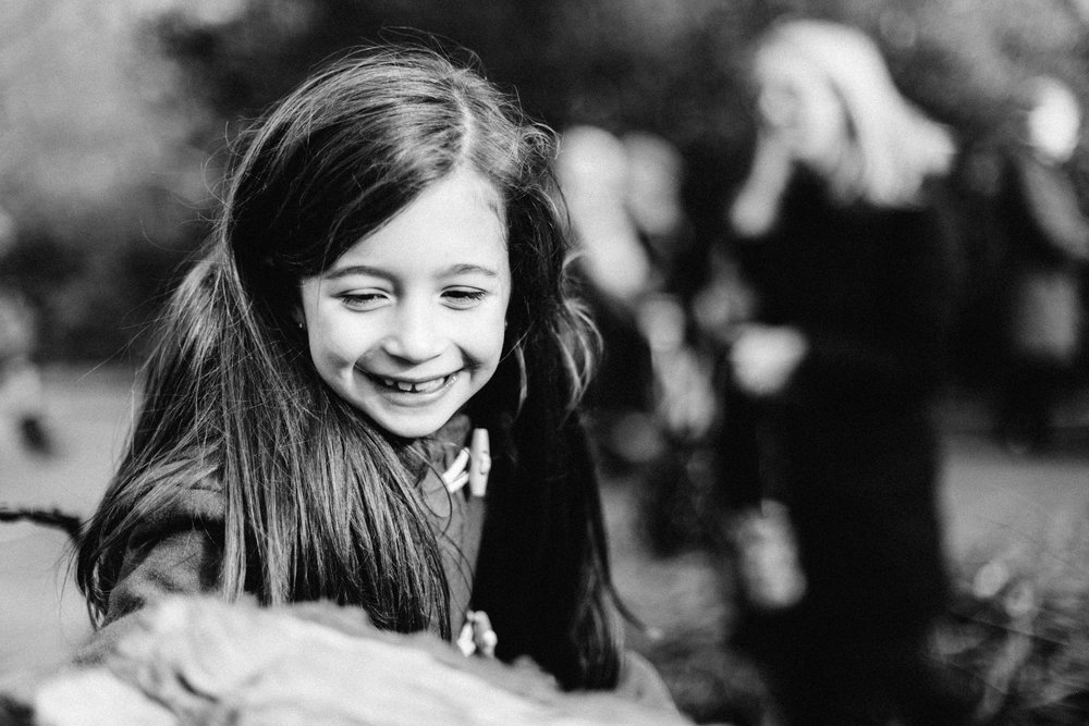 Portrait of young girl smiling during family photo session in Beckenham