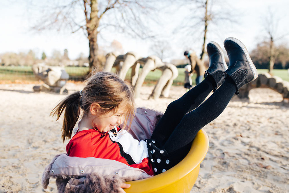Child playing in Crystal Palace's playground during family photoshoot