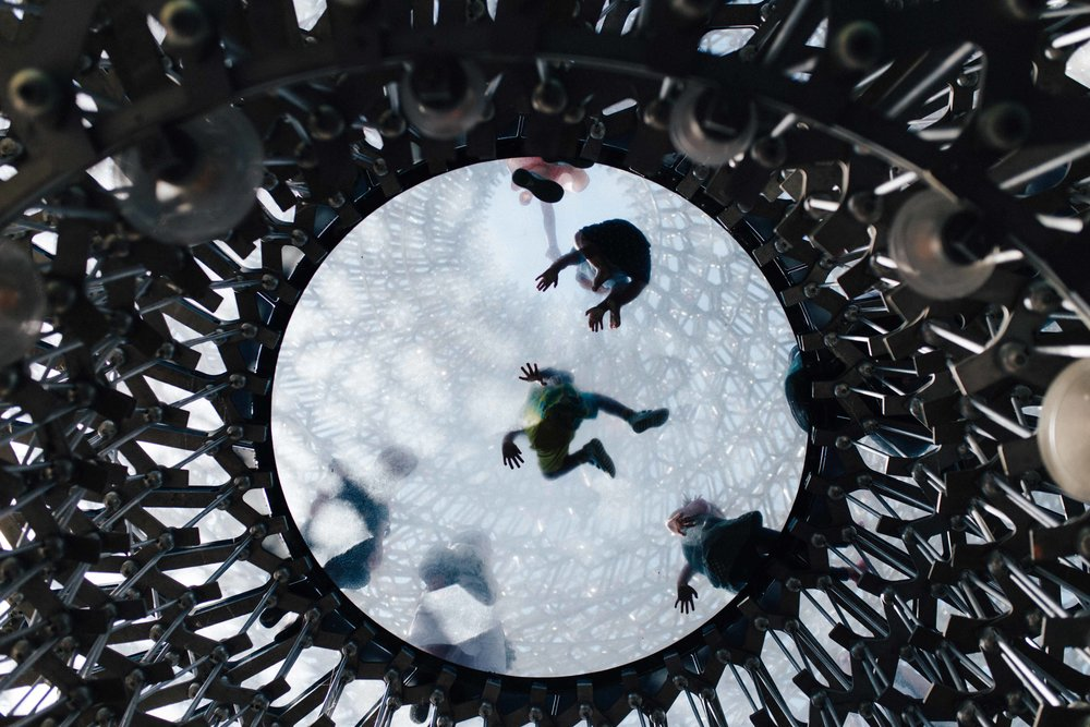 Children seen from below playing in The Hive in Kew Gardens, London