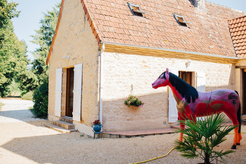 House with statue of a red horse