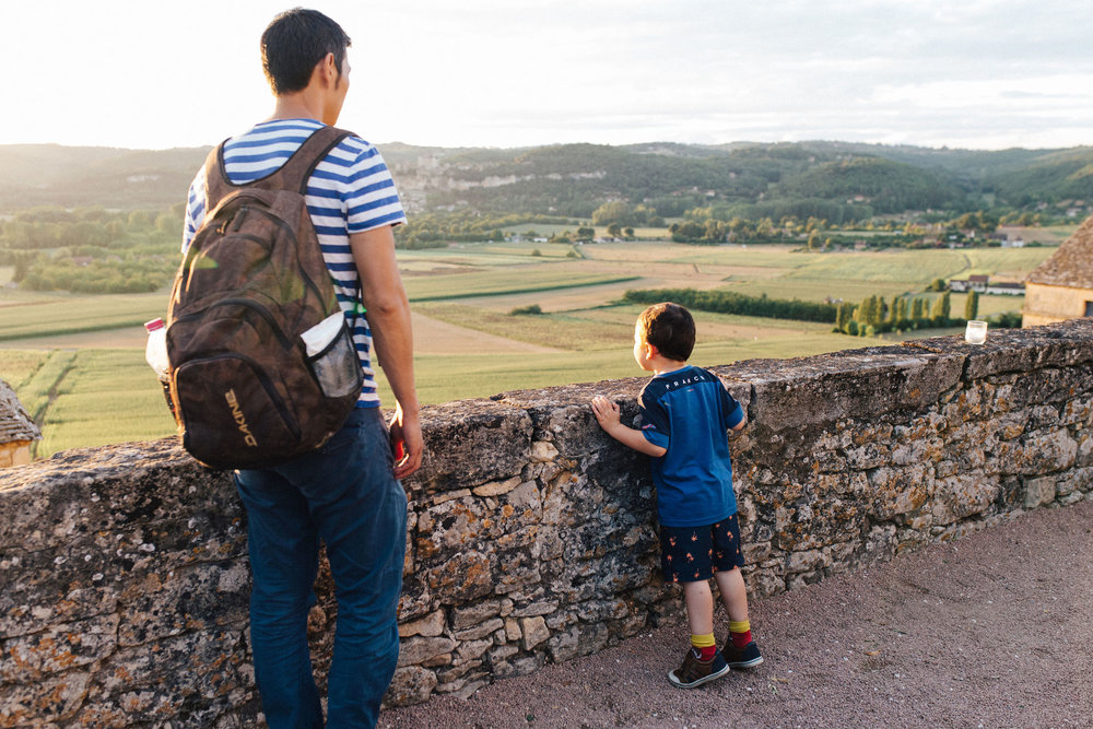 Boy looking at the Dordogne valley from Les Jardins de Marqueyssac