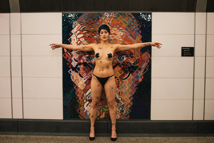 SANGSUK SYLVIA KANG  Performance artist Emma Sulkowicz protests Chuck Close's artwork in the 86th Street subway station in New York by providing their own asterisks on Jan. 30.  Huffington Post