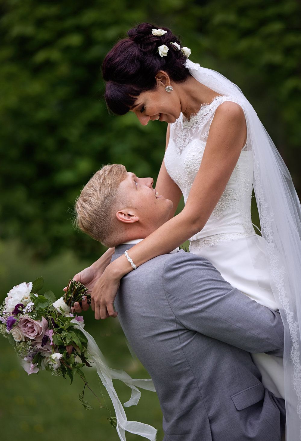 Groom holding the bride, wedding photo