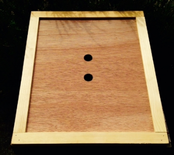 Inner cover made with a pine frame and lauan inner sheet - Perfect for separating the top box and the lid for ventilation, feeding, or to prevent the lid from becoming propolyzed to the hive. Works well when combined with a telescoping or peaked lid.