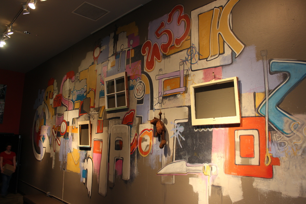 Full wall. With Belleville Set Designer, Kristeen Willis Crosser, volunteering to give scale.