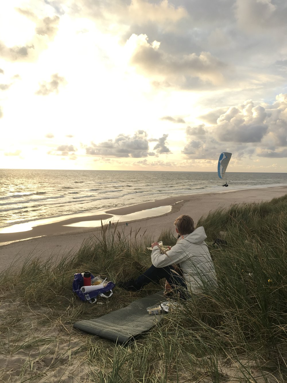 Sunset picnic on the shore of the North Sea.