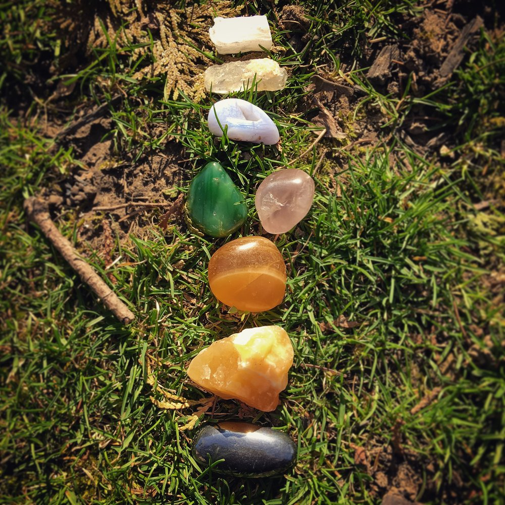Crystal layout for anxiety (from root to crown): hematite, orange calcite, honey calcite, chrysoprase, lithium quartz, blue lace agate, petalite, selenite