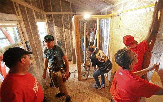 A tiny house-building workshop teaches veterans basic carpentry and building techniques. The three-day workshop was held on a farm in the Racine County community of Mount Pleasant. The tiny houses will provide transitional housing for homeless veterans. For more photos, go to jsonline.com/photos . Credit: Michael Sears