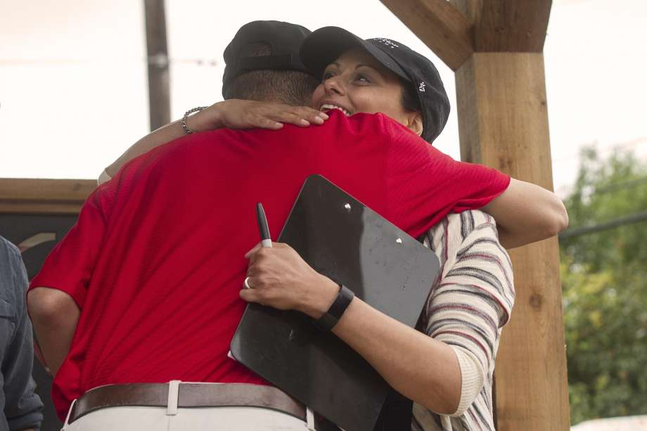 Photo: Alma E. Hernandez, For The San Antonio Express News / Alma E. Hernandez / For The San Antonio Express News  Freddy Rosario, hugs Gabrielle Rapport, co-founder and executive director of Operation Tiny Home after Operation Tiny Home presented Rosario with his new home, Saturday, May 20, 2017 at Warren High School.