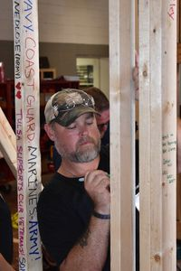 "Sparky Gibson, a below-the knee amputee and a retired Marine Corps master sergeant, left a note of encouragement Friday on the frame of a house going to a local homeless veteran. The house was built at the Indian Capital Technology Center. Gibson wrote, ""A home built with love to a veteran who gave so much."""