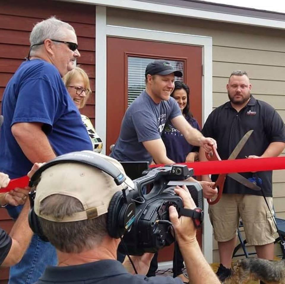 Peter Banach received a home with a low-cost mortgage as part of Operation Tiny Home's effort to help veterans find affordable housing. Banach, 37, was a Marine Corps private first class in 2007 when he was injured by a roadside bomb that shattered his ankle.
