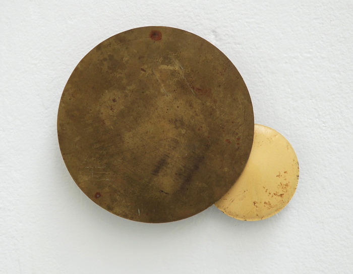 Untitled (Proposal for an Eclipse) , 2009. Found brass and porcelain. 18 x 12 cm