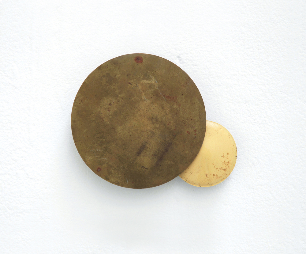 Untitled (Proposal for an Eclipse)  2009 Found brass and porcelain 18 x 12cm