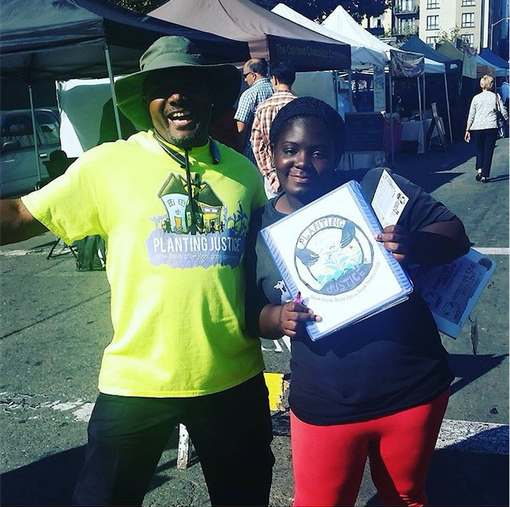 Alisia hard at work raising money and awareness for Planting Justice with fellow staffer Anthony Forrest.