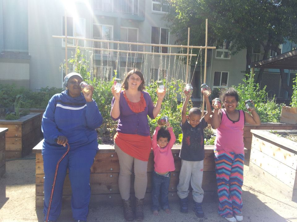 Haleh with Keller Plaza residents making vitamin water in their urban garden.